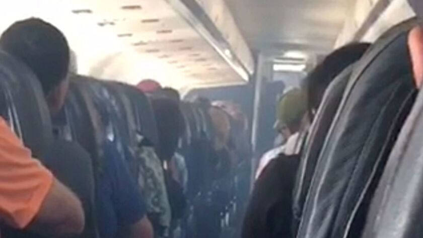 This frame from mobile phone video shows smoke inside an Allegiant Air jet after it landed at Fresno Yosemite International Airport on Monday.