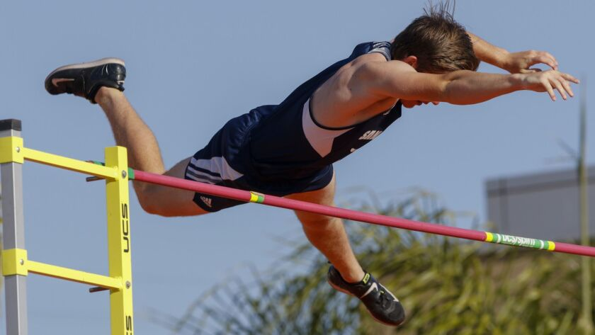 """San Dieguito's pole vaulter Kevin Ward clears 14'9"""" on his way to winning the event with a jump of"""