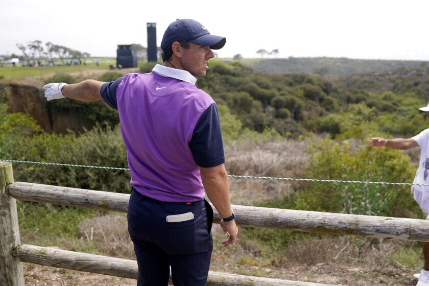 Rory McIlroy, of Northern Ireland, looks for his ball alongside the cart path on the 15th fairway during the third round of the U.S. Open Golf Championship, Saturday, June 19, 2021, at Torrey Pines Golf Course in San Diego. (AP Photo/Jae C. Hong)