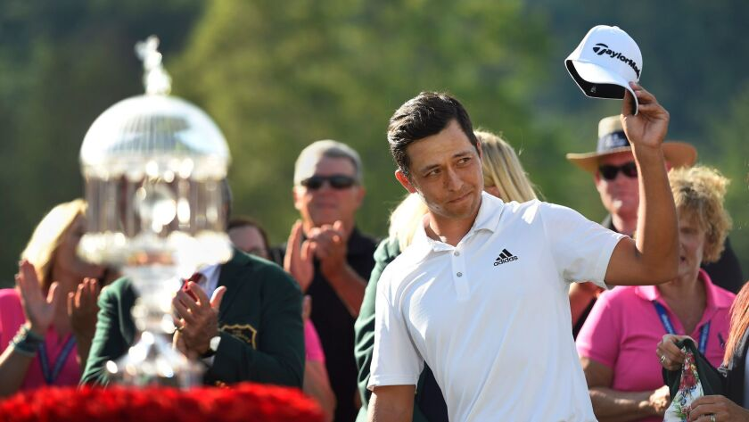 Xander Schauffele acknowledges the crowd after winning The Greenbrier Classic golf tournament at The Old White TPC.