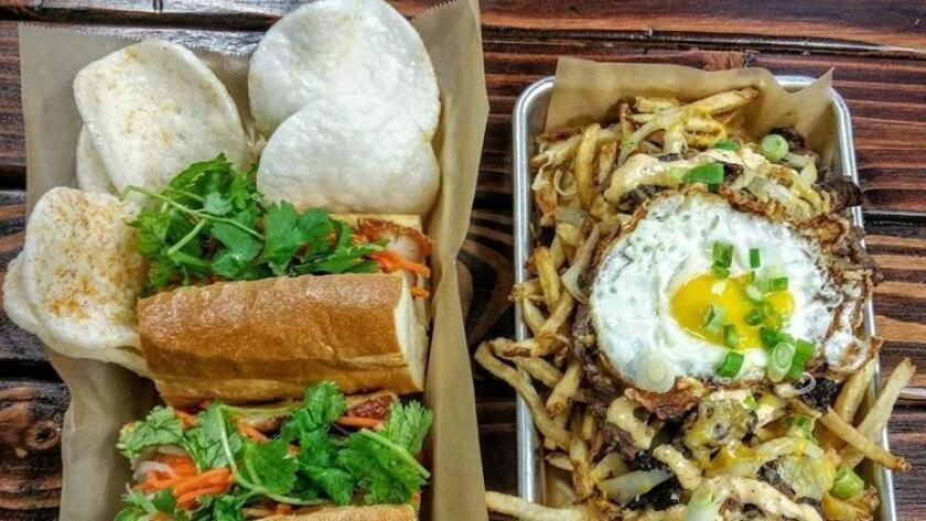 The Belly Flop banh mi with roasted pork belly and beef bulgogi fries from Baguette Bros in Kearny Mesa. (Amy T. Granite)