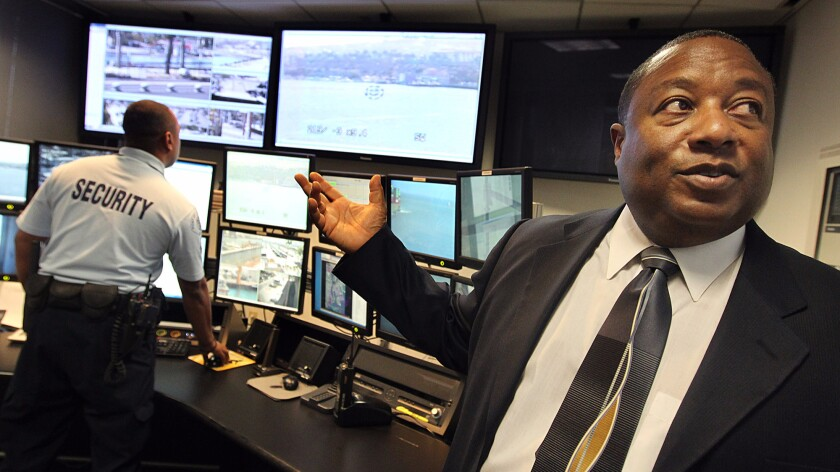 Former Port of Los Angeles Police Chief Ronald J. Boyd, right, visits the port's threat detection center in 2011. Boyd was sentenced to two years in prison Tuesday after pleading guilty to federal tax evasion charges.