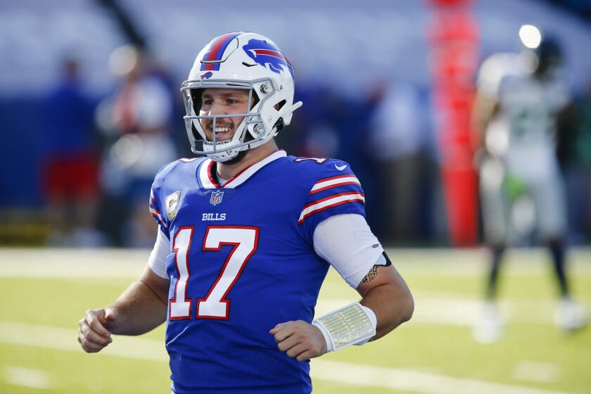 Buffalo Bills quarterback Josh Allen (17) smiles after throwing a touchdown pass to Isaiah McKenzie during the first half of an NFL football game against the Seattle Seahawks Sunday, Nov. 8, 2020, in Orchard Park, N.Y. (AP Photo/John Munson)