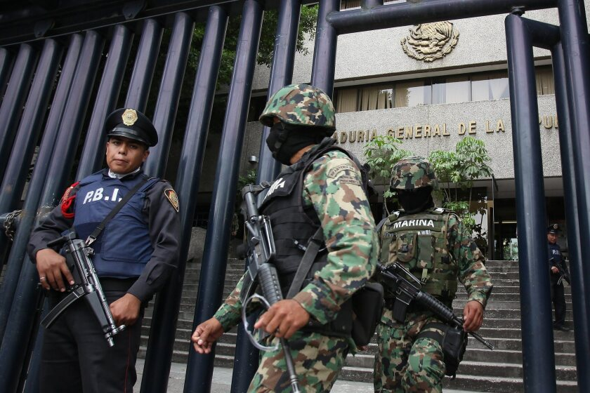 Mexican soldiers guard the building where Miguel Angel Treviño Morales, alias Z-40, is being held. The Mexican government arrested Morales in their fight against drug trafficking.