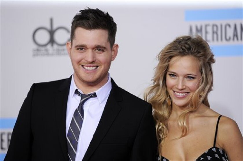 Michael Buble, left, and Luisana Lopilato at the 38th Annual American Music Awards in Los Angeles. The Canadian singer and his 25-year-old Argentine actress-wife were married in 2011 and are expecting their first child to be born this summer. (AP Photo/Chris Pizzello, file)