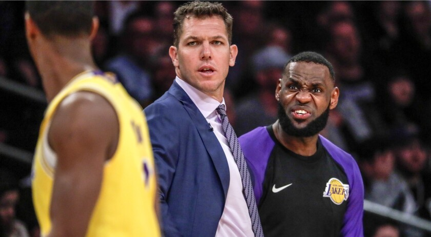 LOS ANGELES, CA, THURSDAY FEBRUARY 21, 2019 - Lakers coach Luke Walton and LeBron James talk with gu