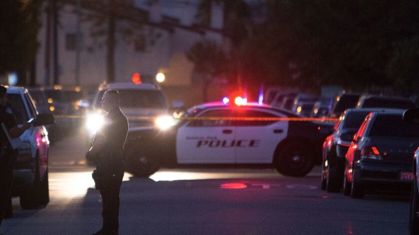 Baldwin Park police block a street. The former police chief is suing the city over his firing, alleging discrimination.