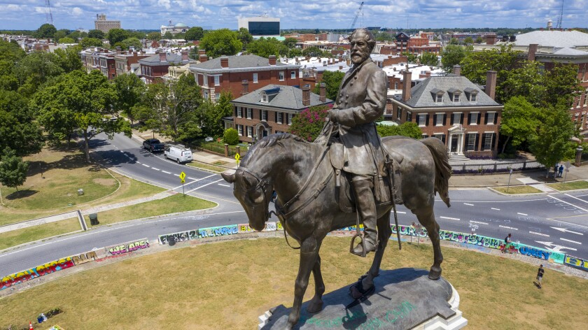 EDS NOTE: OBSCENITY - FILE - In this Friday, July 10, 2020, file photo is the statue of Confederate General Robert E. Lee Monument Avenue in Richmond, Va. The Supreme Court of Virginia is set to hear arguments Tuesday, June 8, 2021, in legal challenges to Virginia Gov. Ralph Northam's plan to take down the 131-year-old statue of Confederate Gen. Robert E. Lee. (AP Photo/Steve Helber, File)
