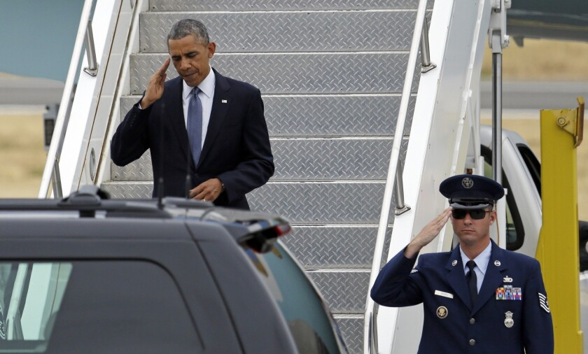 President Obama arrives in Seattle, where an aide discussed the White House's new plan for addressing religious objections to birth control insurance coverage.
