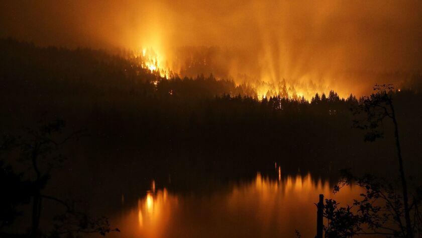 The Eagle Creek fire burns along the Oregon side of the Columbia River Gorge near Cascade Locks, Ore