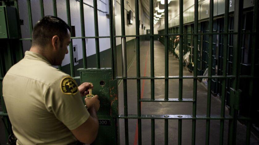 LOS ANGELE3, CA--NOVEMBER 2, 2011-A Los Angeles County Sheriff's deputy prepares to unlock a securit