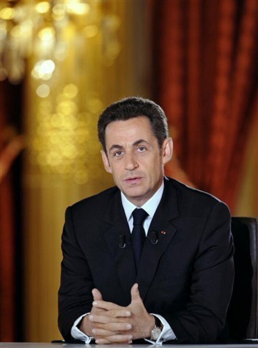 French President Nicolas Sarkozy is seen during a prime-time television interview with journalists at the Elysee Palace in Paris, Thursday, Feb. 5, 2009. Nicolas Sarkozy faces a grilling on national television Thursday over his handling of the economy following nationwide strikes sparked by fears of job layoffs. (AP Photo/Gerard Cerles, Pool)