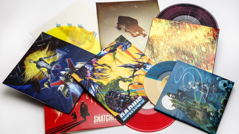 A selection of vinyl records of video game scores on multicolored vinyl, with deluxe packaging and detailed liner notes.