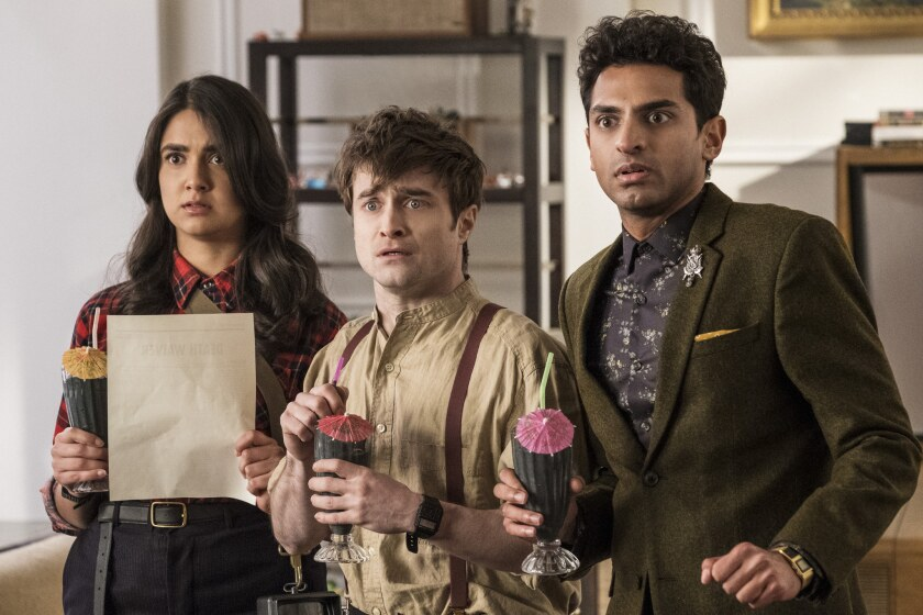 "Geraldine Viswanathan, Daniel Radcliffe and Karan Soni in the TBS comedy ""Miracle Workers"""