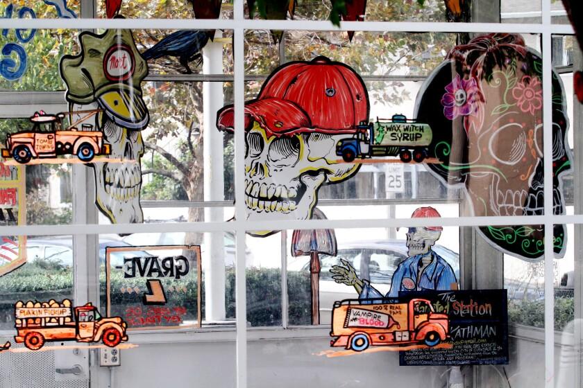 "Artist Bob Kathman's ""Haunted Gas Station"" is on display at Adams Square Mini Park."