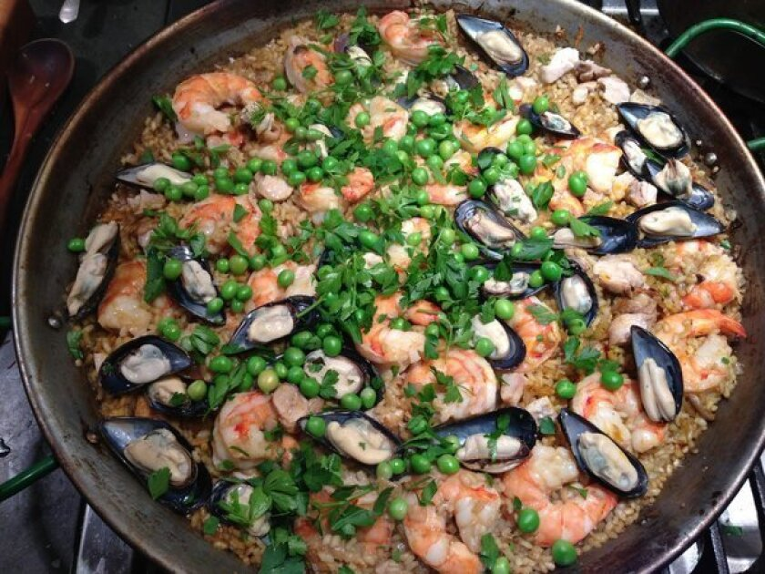 Paella with chicken, shrimp, and mussels, a great match with an older white Rioja