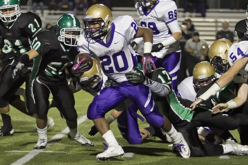 St. Augustine running back Elijah Preston says he stands about 5-feet-4 and weighs 168 pounds.