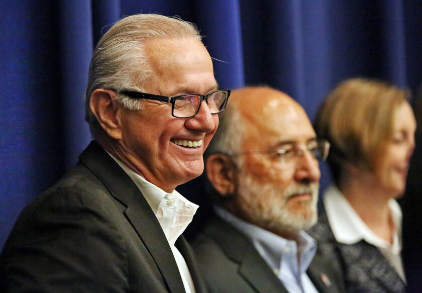 James Henwood Jr., left, chief executive of the Los Angeles County Fair Assn., and J. Michael Ortiz, president of the fair association's board of directors, at a Board of Supervisors meeting Sept. 1.