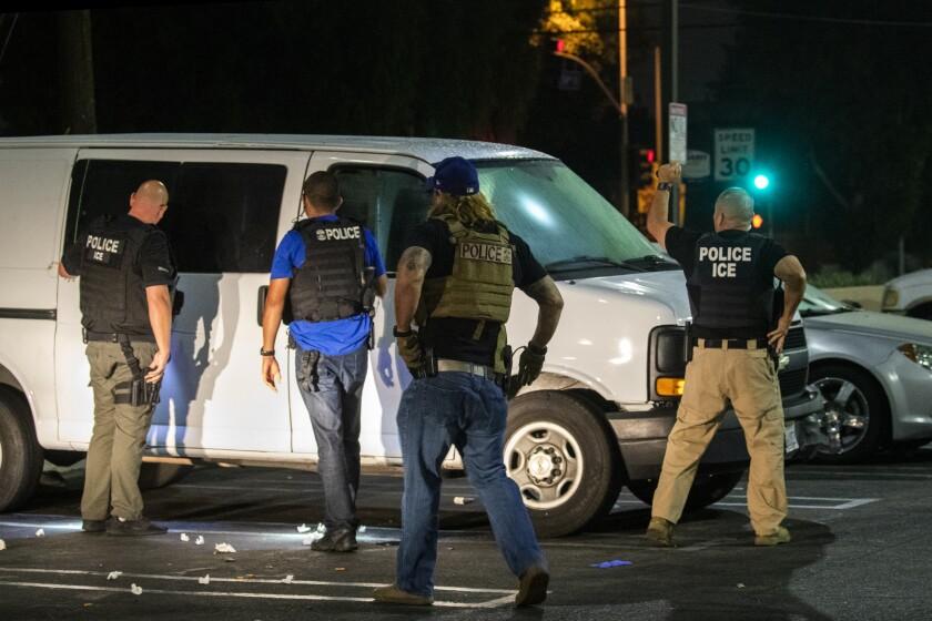 Immigration and Customs Enforcement officials raid a van
