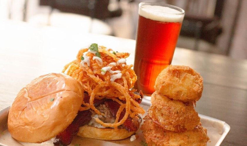 The Suicide Burger comes with a 1/2-pound patty, candied bacon, pepper jack cheese, lettuce, tomato, onion and jalapeno jam, paired with hand-cut 1919 fries.