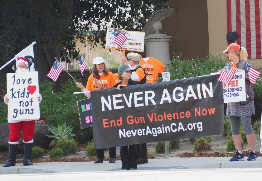 Gun show protesters gathered in front of the Del Mar Fairgrounds on Dec. 14.