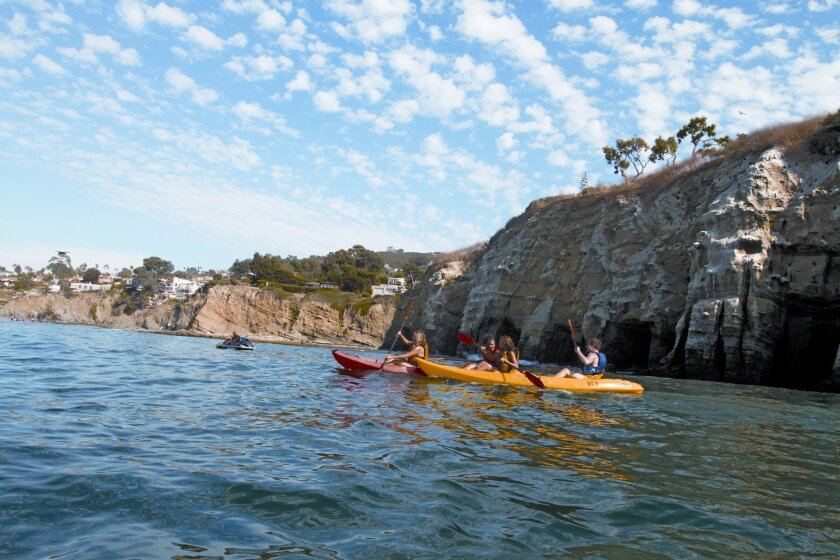 Kayakers near the La Jolla cliffs are part of a San Diego tourism TV commercial that may get an overhaul.