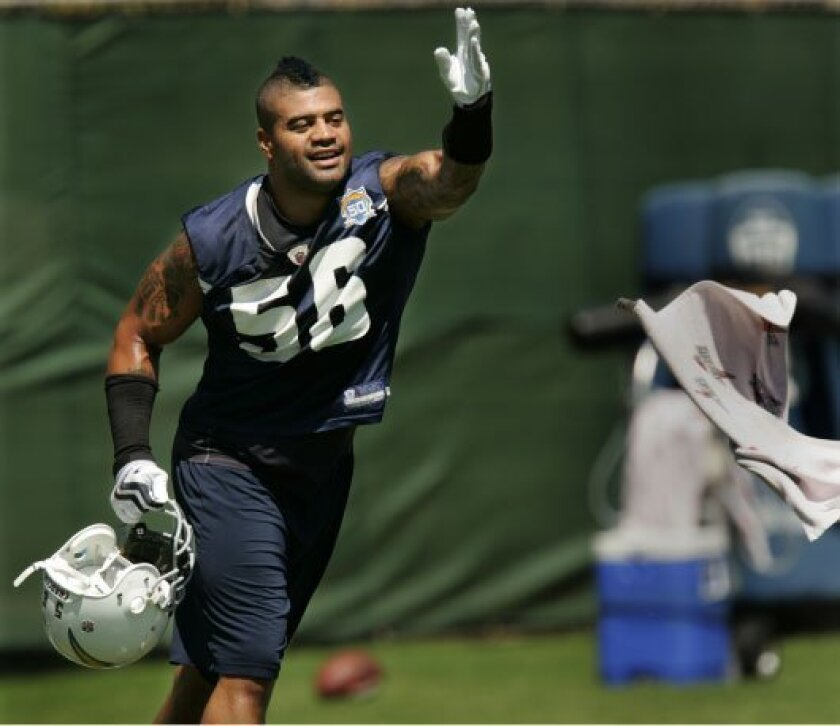 Shawne Merriman isn't short of emotion the day after being arrested at his Poway home.