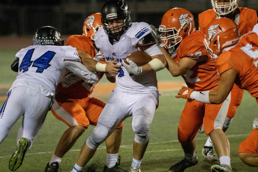 Jake Maheu carries the ball for West Hills, which will play Scripps Ranch in the quarterfinals on Friday.
