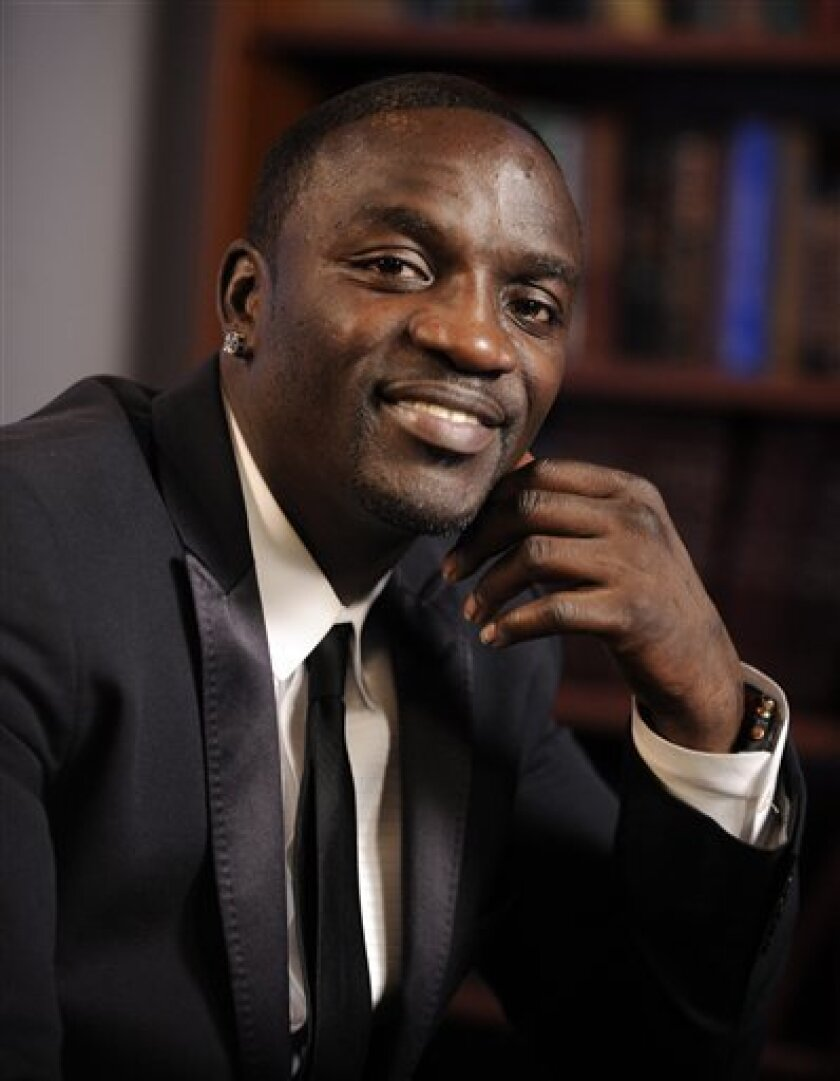 R&B singer Akon poses for a photo in New York, Monday, Nov. 24, 2008. (AP Photo/Richard Drew)
