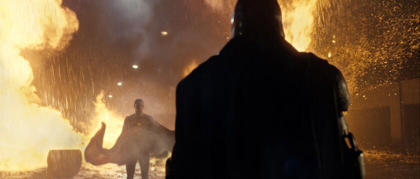 "Henry Cavill as Superman, left, and Ben Affleck as Batman in Warner Bros. Pictures' ""Batman v Superman: Dawn of Justice."""