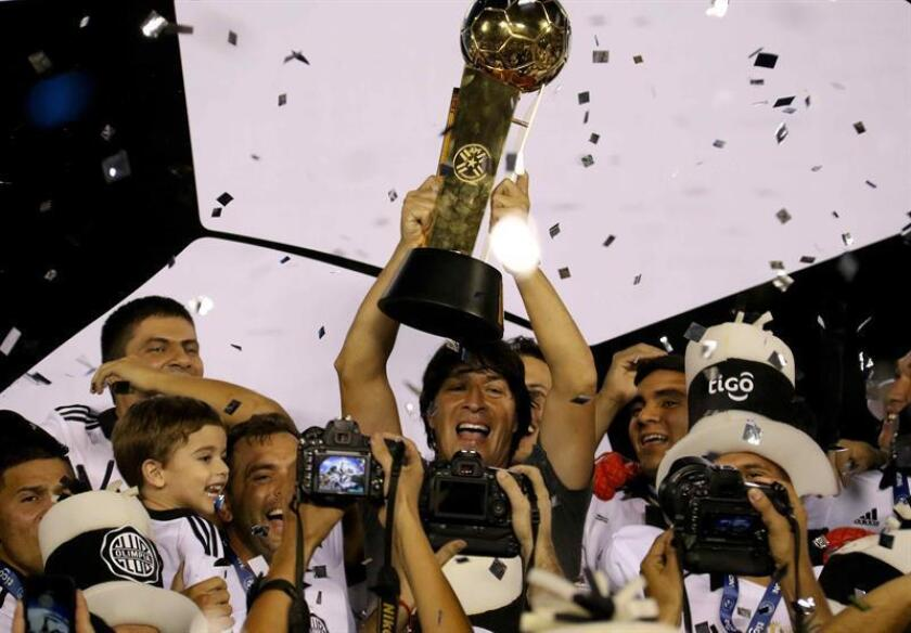 Olimpia players celebrate after winning the Paraguay tournament on Nov. 28, 2018 by defeating Guaraní, at the Defensores del Chaco stadium in Asuncion (Paraguay). EPA-EFE/Andrés Cristaldo