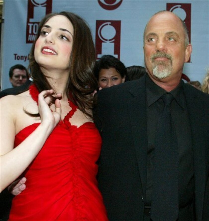 FILE- In this June 6, 2004 file photo, pianist, singer and songwriter, Alexa Ray Joel, left, joins her father, Billy Joel, for the arrivals of the 58th Annual Tony Awards at Radio City Music Hall, in New York. Alexa Ray Joel's publicist, Claire Mercuri, says that the performer has been hospitalized in New York on Saturday, Dec. 5, 2009 for an undisclosed condition.(AP Photo/AP Photo/Diane Bondareff, File)