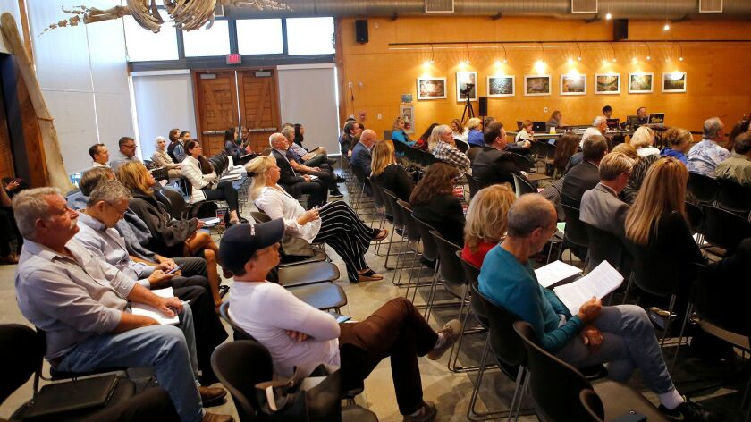 A full house hears remarks as the Coastal Community Commission comments on the Laguna Beach short-te