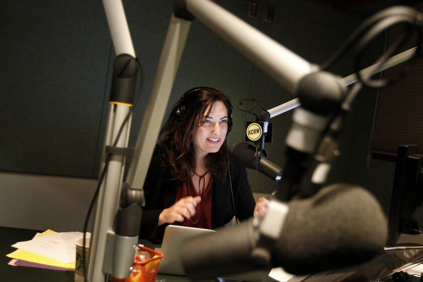 SANTA MONICA-CA-JANUARY 22, 2014: Madeleine Brand, host of Press Play, works in her studio at KCRW i