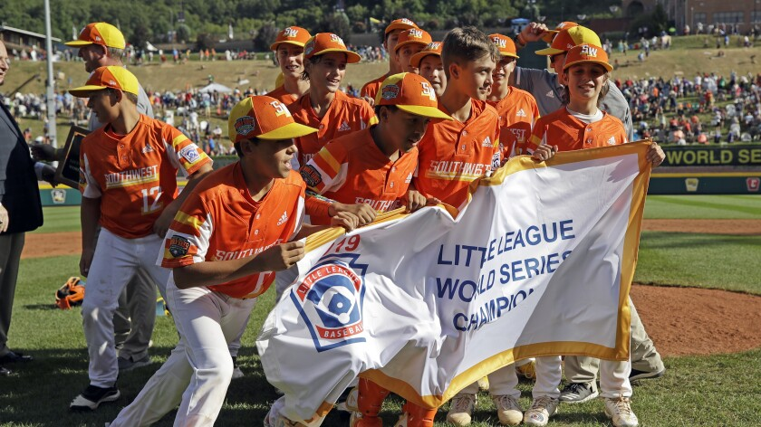 Players from Eastback, La., celebrate after winning the 2019 Little League World Series championship game in South Williamsport, Pa.