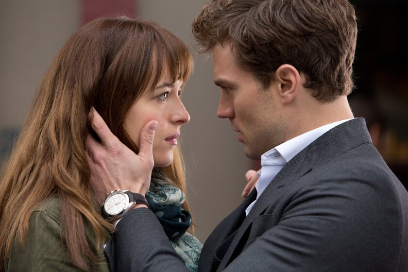 """Dakota Johnson, left, and Jamie Dornan in a scene from """"Fifty Shades of Grey,"""" which broke box office records for Presidents Day weekend."""