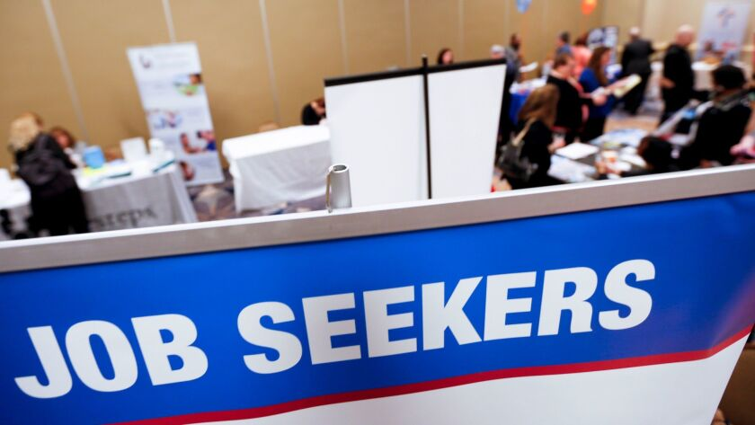 Employment seekers attend a jobs fair in Pittsburgh in March 2016. The Labor Department reported Friday that the unemployment rate dipped to 4.7% from 4.8% as employers added 235,000 workers.