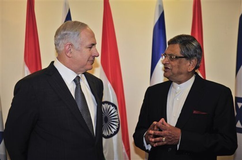 Israeli Prime Minister Benjamin Netanyahu, left, meets with Indian Foreign Minister S.M. Krishna in his office in Jerusalem, Tuesday, Jan. 10, 2012. Indian Foreign Minister S.M. Krishna is on an official visit to Israel and the Palestinian territories. (AP Photo/Yin Dongxun, Pool)