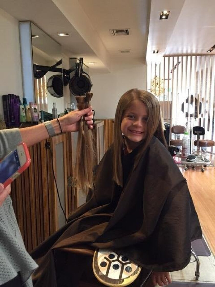 Six-year-old Ryder Perryman with her donated hair