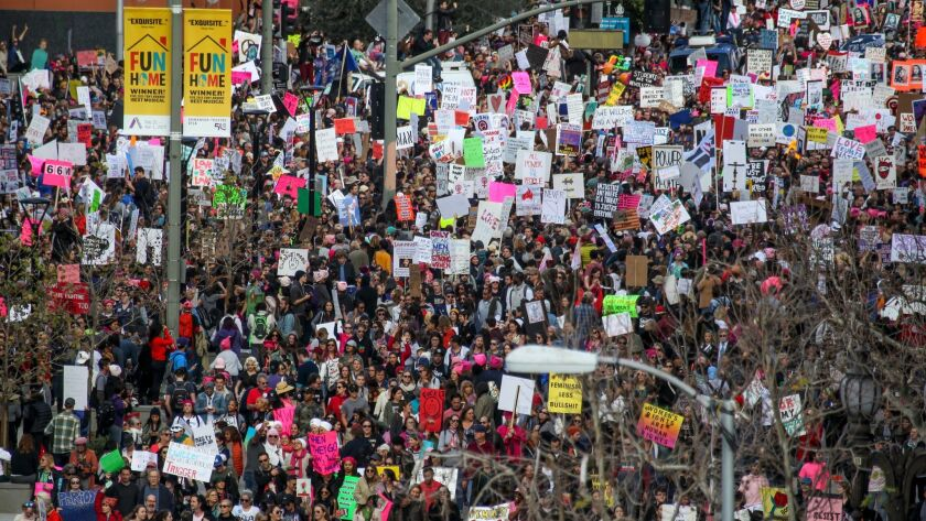 Thousands of participants walk down Broadway in downtown Los Angeles during the women's march Saturday.