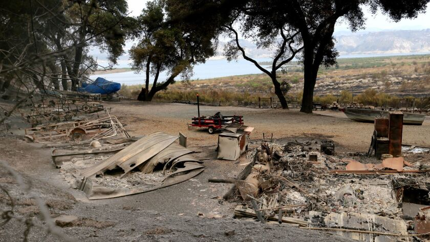 The remains of a structure and boats scorched by the Whittier fire in Los Padres National Forest nea