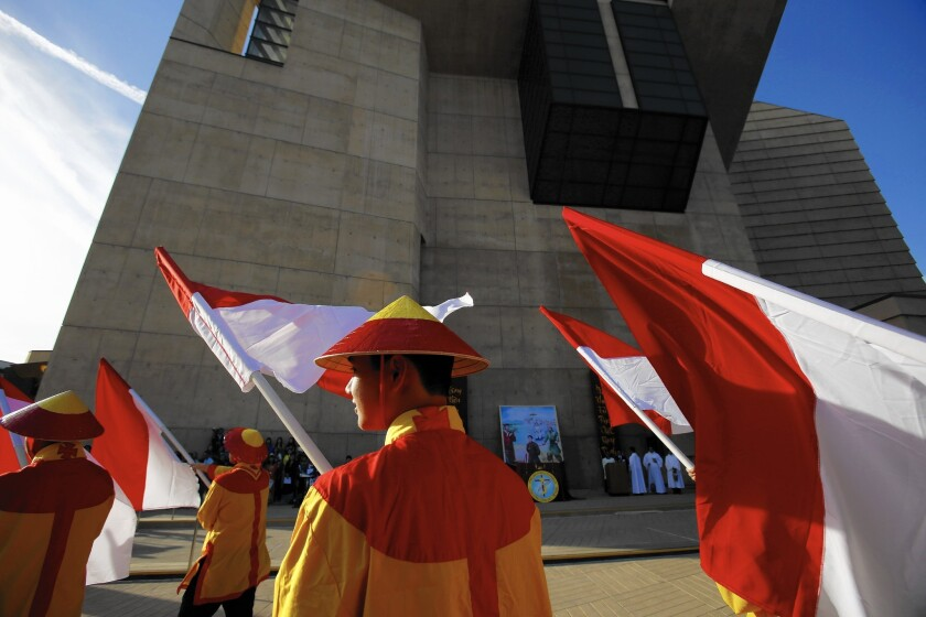 A colorful procession outside the Cathedral of Our Lady of the Angels in downtown L.A. celebrates martyrs and the birth of Catholicism in Vietnam.