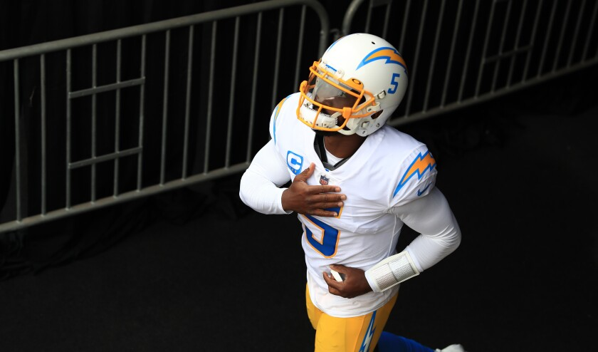 Chargers quarterback Tyrod Taylor runs onto the field before a game against the Cincinnati Bengals on Sept. 13.
