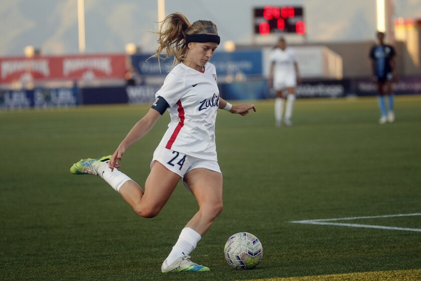 OL Reign forward Bethany Balcer (24) takes shot during the first half of an NWSL Challenge Cup soccer match against the Sky Blue FC at Zions Bank Stadium on Tuesday, June 30, 2020, in Herriman, Utah. Balcer didn't come to the National Women's Soccer League by way of a powerhouse college program like North Carolina or UCLA. She didn't come to the league with a national team history or as a top draft pick, either. Balcer forged her own path to OL Reign. (AP Photo/Rick Bowmer)