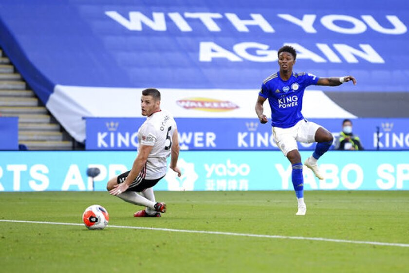 Leicester's Demarai Gray, right, scores his side's second goal during the English Premier League soccer match between Leicester City and Sheffield United at the King Power Stadium, in Leicester, England, Thursday, July 16, 2020. (Michael Regan/Pool via AP)