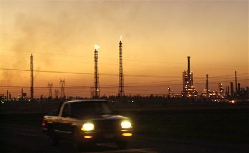FILE - A truck drives past a refinery in Salamanca, Mexico, 170 miles (280 kilometers) northwest of Mexico City on Saturday, Jan. 19, 2002. President Enrique Pena Nieto's proposal to revamp energy policy and modernize the state-owned Petroleos Mexicanos (Pemex), expected to be unveiled in August 20