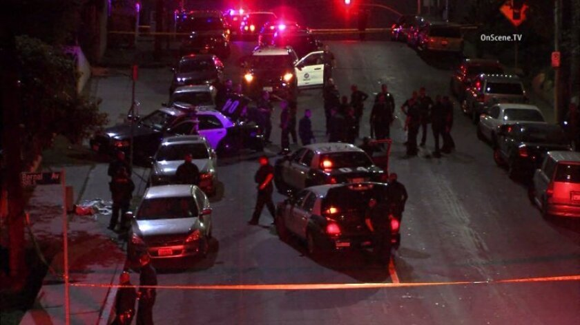 A 16-year-old boy who was armed with a gun was fatally shot Saturday night during a confrontation with LAPD officers, authorities said.