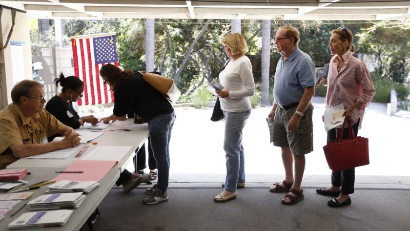 SHERMAN OAKS, CA - JUNE 07, 2016 -Voters crowd the garage of a home in Sherman Oaks to vote in Tuesd