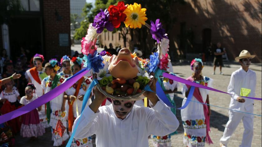 People gathered at the plaza adjacent to Olvera Street to celebrate Dia de los Muertos, or Day of the Dead, in Los Angeles on Nov. 1, 2015.