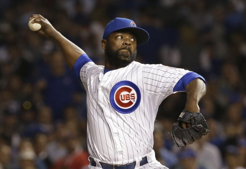 FILE - In this Wednesday, Oct. 21, 2015 file photo, Chicago Cubs pitcher Fernando Rodney throws during the eighth inning of Game 4 of the National League baseball championship series against the New York Mets in Chicago. Reliever Fernando Rodney and the San Diego Padres have completed their $2 mill